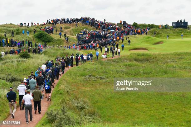 Matt Kuchar of the United States and Jordan Spieth of the United States on the 12th hole during the final round of the 146th Open Championship at...