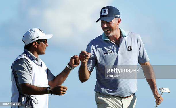 Matt Kuchar of the United States celebrates his birdie with his caddie on the 15th green during the second round of the Mayakoba Golf Classic at El...