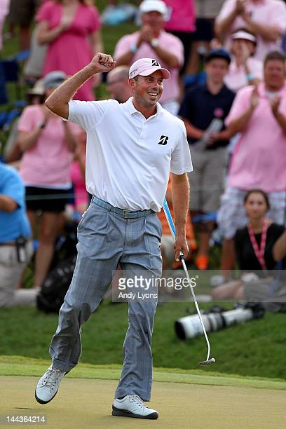 Matt Kuchar of the United States celebrates his twostroke victory on the 18th hole during the final round of THE PLAYERS Championship held at THE...