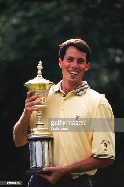 Matt Kuchar of the United States celebrates holding the trophy after winning the United States Amateur Championship golf tournament on 24th August...