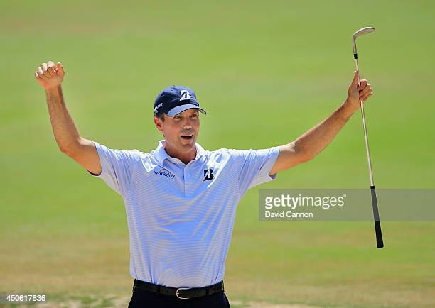 Matt Kuchar of the United States celebrates holing a bunker shot to make birdie on the fourth hole during the third round of the 114th US Open at...