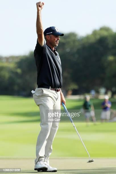 Matt Kuchar of the United States celebrates on the 18th green after winning during the final round of the Mayakoba Golf Classic at El Camaleon...