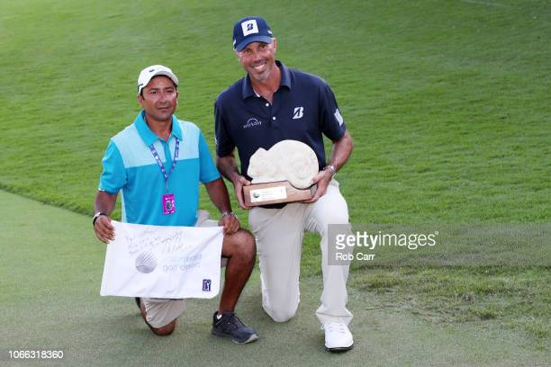 Matt Kuchar of the United States celebrates with caddie El Tucan on the 18th green after winning during the final round of the Mayakoba Golf Classic...