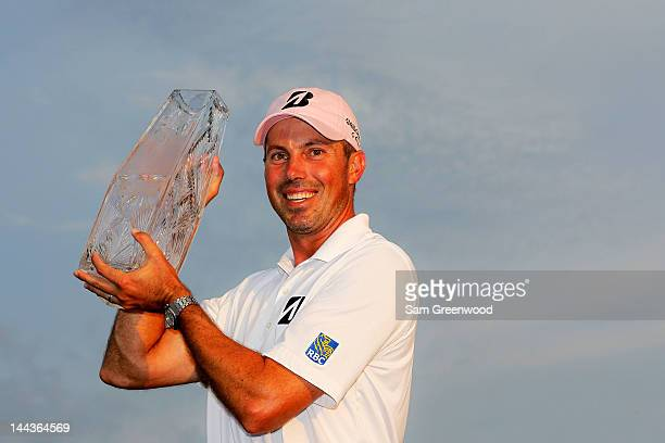 Matt Kuchar of the United States celebrates with the trophy after his twostroke victory during the final round to win THE PLAYERS Championship held...