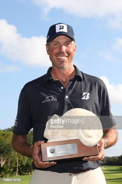 Matt Kuchar of the United States celebrates with the winner's trophy on the 18th green after the final round of the Mayakoba Golf Classic at El...