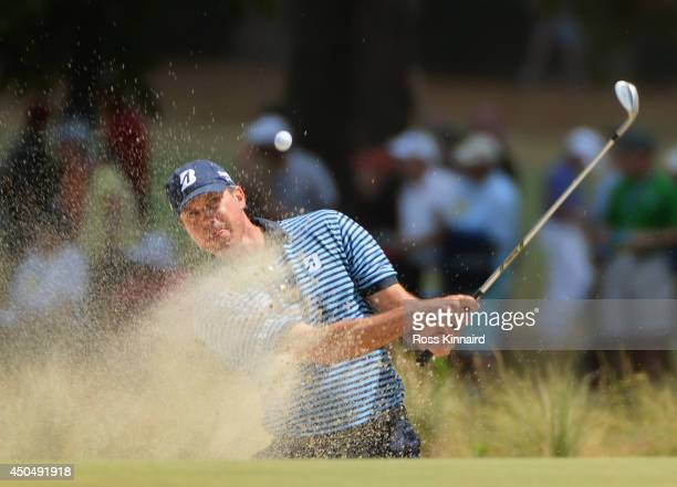 Matt Kuchar of the United States hits a bunker shot on the 17th hole during the first round of the 114th US Open at Pinehurst Resort Country Club...