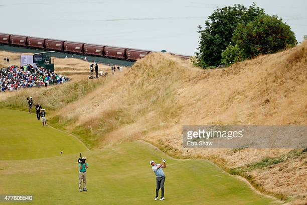 Matt Kuchar of the United States hits an approach shot on the 12th hole during the first round of the 115th US Open Championship at Chambers Bay on...
