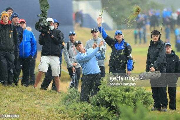 Matt Kuchar of the United States hits his second shot on the 18th hole during day three of the AAM Scottish Open at Dundonald Links Golf Course on...