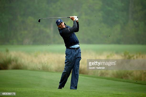 Matt Kuchar of the United States hits his second shot on the seventh hole during the final round of the Shell Houston Open at the Golf Club of...