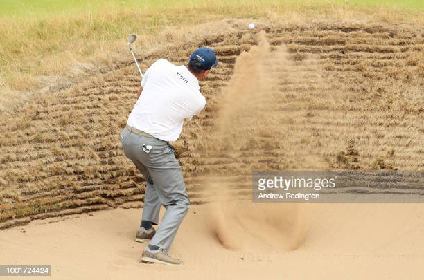 Matt Kuchar of the United States hits his third shot from a bunker on the 15th hole during the first round of the 147th Open Championship at...