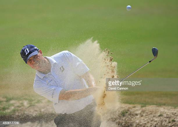 Matt Kuchar of the United States hits his third shot from a bunker on the fourth hole during the third round of the 114th U.S. Open at Pinehurst...