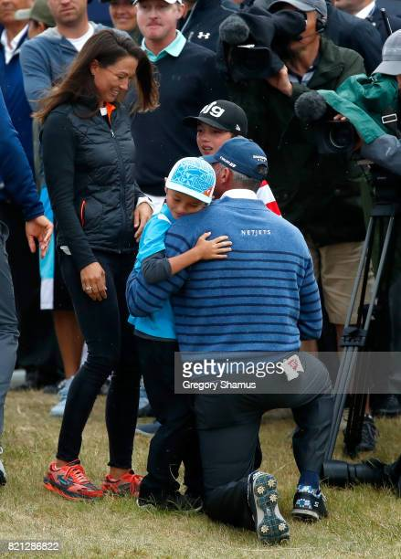 Matt Kuchar of the United States is congratulated by his children and wife Sybi Kuchar on the 18th green during the final round of the 146th Open...