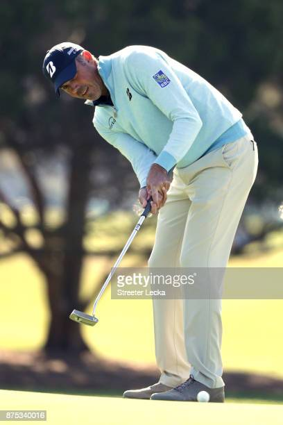 Matt Kuchar of the United States lines up a putt on the first hole during the first round of The RSM Classic at Sea Island Golf Club Seaside Course...