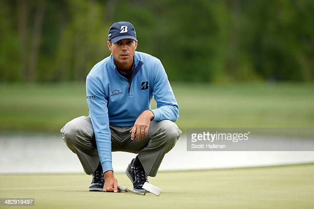 Matt Kuchar of the United States lines up a shot on the green of the seventh hole during round three of the Shell Houston Open at the Golf Club of...
