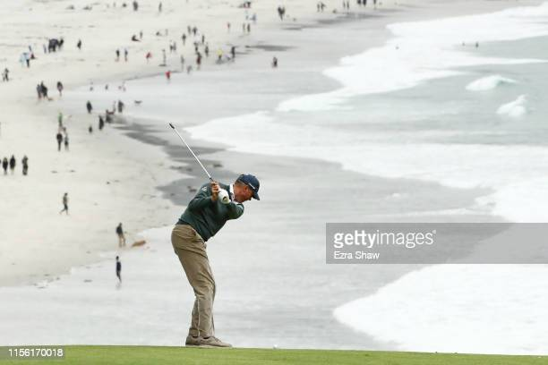 Matt Kuchar of the United States plays a second shot on the ninth hole during the third round of the 2019 US Open at Pebble Beach Golf Links on June...