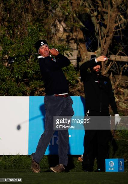 Matt Kuchar of the United States plays a shot as Adam Hadwin of Canada looks on during a practice round prior to the ATT Pebble Beach ProAm at Pebble...