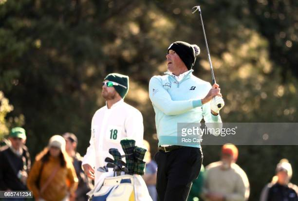 Matt Kuchar of the United States plays a shot on the first hole as caddie John Wood during the second round of the 2017 Masters Tournament at Augusta...