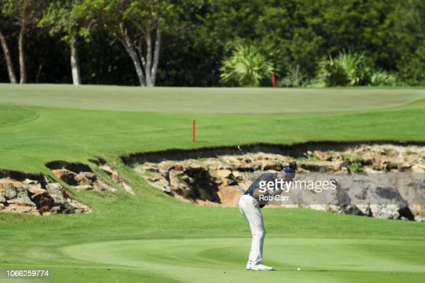 Matt Kuchar of the United States plays his second shot on the sixth hole during the final round of the Mayakoba Golf Classic at El Camaleon Mayakoba...