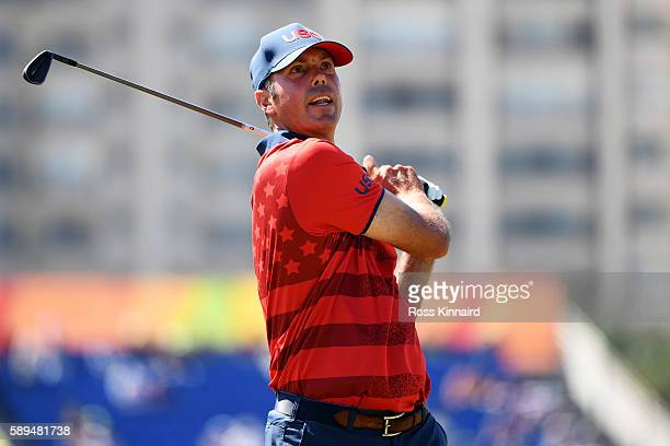 Matt Kuchar of the United States plays his shot from the eighth tee during the final round of men's golf on Day 9 of the Rio 2016 Olympic Games at...