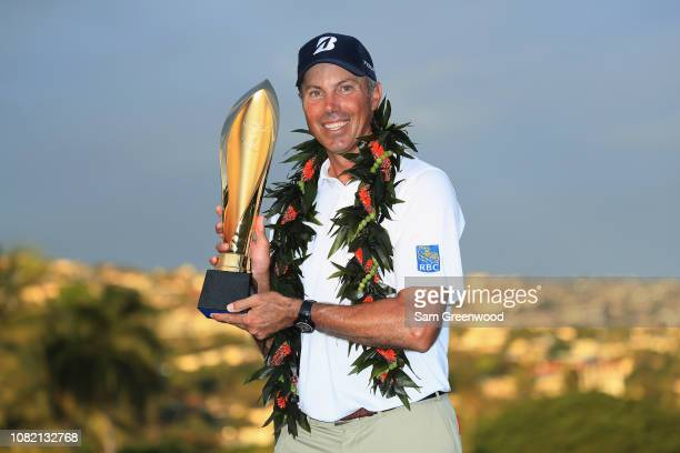 Matt Kuchar of the United States poses with the trophy after winning the Sony Open In Hawaii at Waialae Country Club on January 13 2019 in Honolulu...