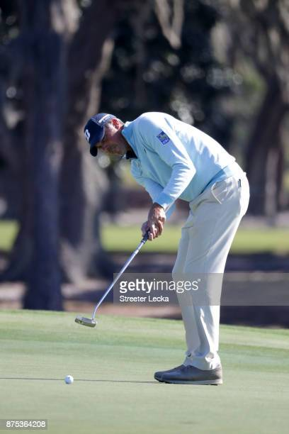 Matt Kuchar of the United States putts on the second hole during the first round of The RSM Classic at Sea Island Golf Club Seaside Course on...