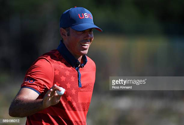 Matt Kuchar of the United States reacts to his birdie putt on the 15th green during the final round of men's golf on Day 9 of the Rio 2016 Olympic...