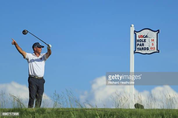 Matt Kuchar of the United States reacts to his shot from the 14th tee during the second round of the 2017 U.S. Open at Erin Hills on June 16, 2017 in...