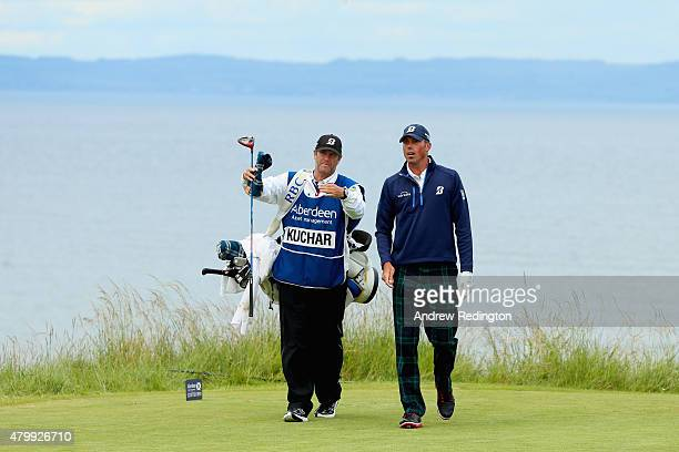 Matt Kuchar of the United States talks with caddie Lance Bennett on the ninth tee during the ProAm prior to the start of the Aberdeen Asset...