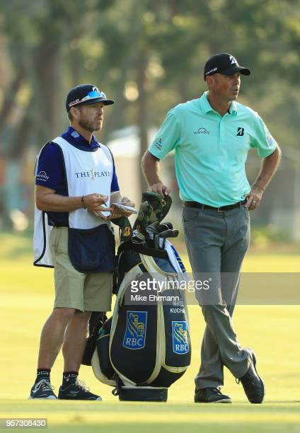 Matt Kuchar of the United States talks with his caddie John Wood on the 11th hole during the second round of THE PLAYERS Championship on the Stadium...