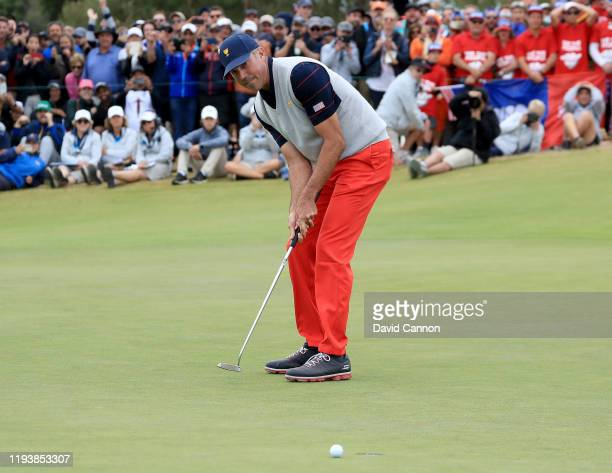 Matt Kuchar of the United States Team just misses a putt for birdie on the 18th hole in his match with Tony Finau in their match against Byeong Hun...