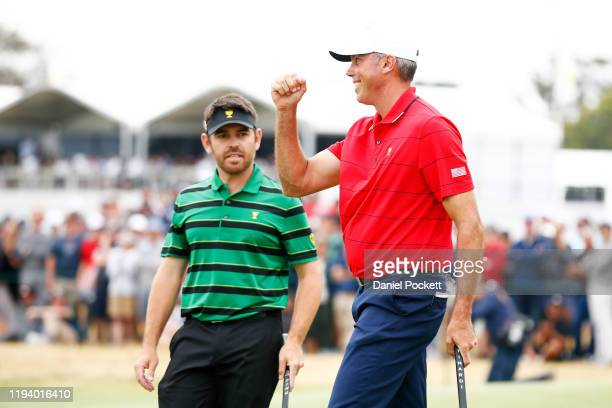 Matt Kuchar of the United States team reacts after going 1up over Louis Oosthuizen of South Africa and the International team on the 17th green to...