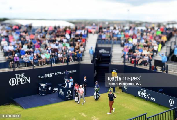 Matt Kuchar of the United States tees off on the first hole during the third round of the 148th Open Championship held on the Dunluce Links at Royal...