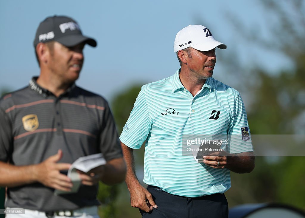 Matt Kuchar of the United States walks with Louis Oosthuizen of South Africa during round three of the Hero World Challenge at Albany, The Bahamas on December 3, 2016 in Nassau, Bahamas.