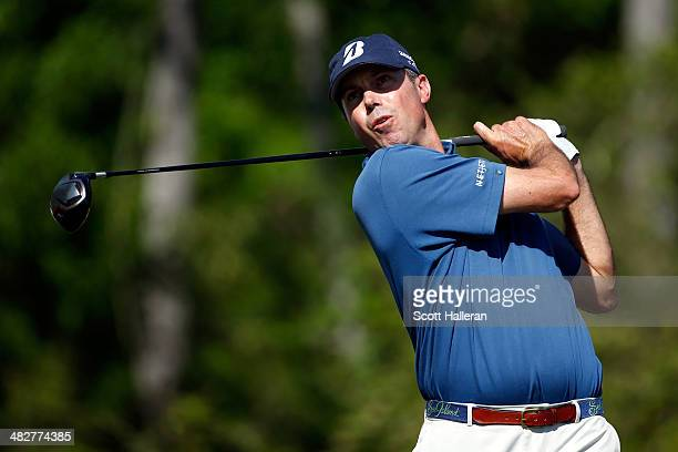 Matt Kuchar of the United States watches his tee shot on the thirteenth hole during round two of the Shell Houston Open at the Golf Club of Houston...