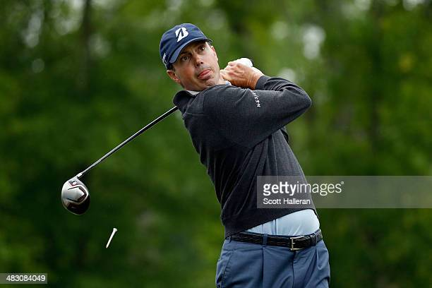 Matt Kuchar of the United States watches his tee shot on the fifteenth hole during the final round of the Shell Houston Open at the Golf Club of...
