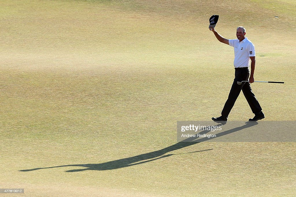 Matt Kuchar of the United States waves after making a putt for birdie on the 18th green during the second round of the 115th U.S. Open Championship at Chambers Bay on June 19, 2015 in University Place, Washington.
