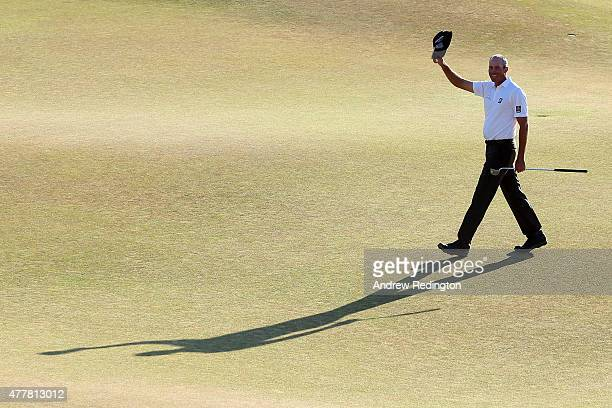 Matt Kuchar of the United States waves after making a putt for birdie on the 18th green during the second round of the 115th US Open Championship at...
