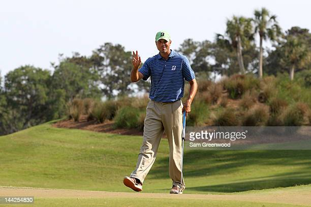 Matt Kuchar of the United States waves after putting on the 12th green during the third round of THE PLAYERS Championship held at THE PLAYERS Stadium...