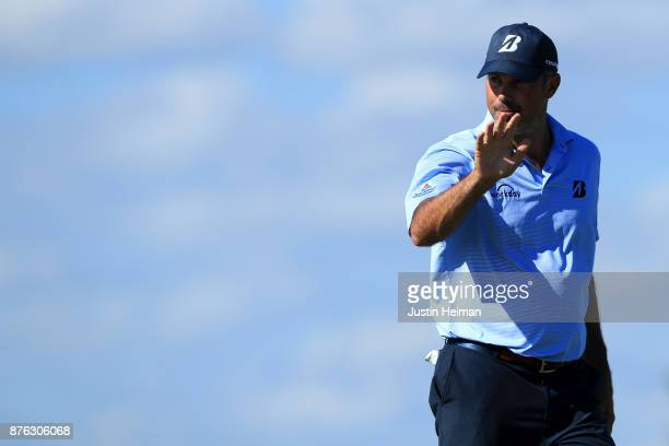 Matt Kuchar of the United States waves after putting on the 15th hole during the third round of The RSM Classic at Sea Island Golf Club Seaside...