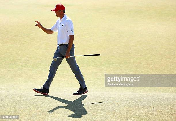 Matt Kuchar of the United States waves to the gallery on the 18th green during the final round of the 115th US Open Championship at Chambers Bay on...