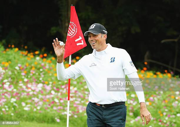 Matt Kuchar of the Unites States waves to the gallery after a hole-in-one on the 17th hole during the third round of the WGC - HSBC Champions at the...