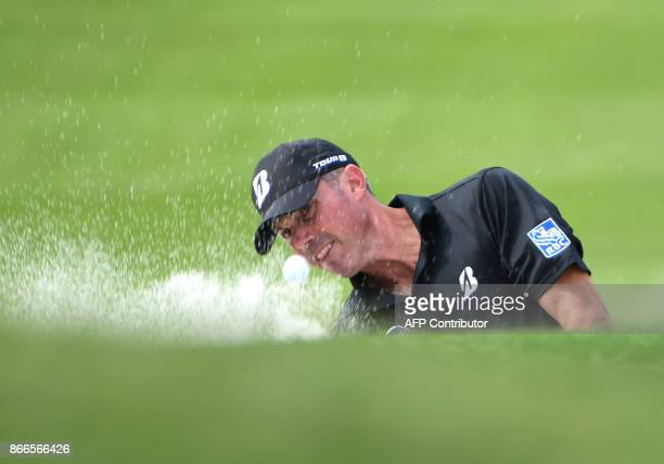 Matt Kuchar of the US blasts a shot from the bunker during the first round at the WGCHSBC Champions at the Sheshan International golf club in...