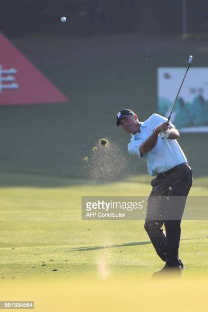 Matt Kuchar of the US hits a shot during the third round of the WGCHSBC Champions at the Sheshan International golf club in Shanghai on October 28...