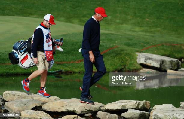 Matt Kuchar of the US Team and caddie John Wood walk to the 13th tee during the Saturday morning foursomes matches during the third round of the...
