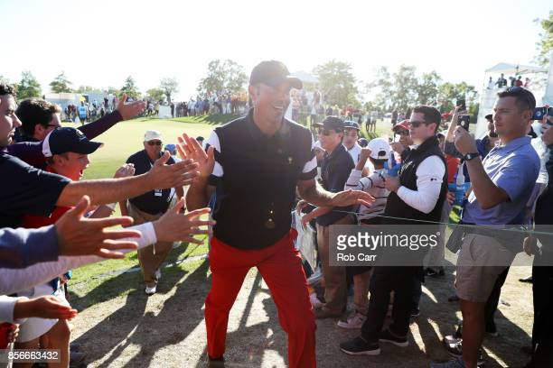 Matt Kuchar of the US Team greets fans during Sunday singles matches of the Presidents Cup at Liberty National Golf Club on October 1 2017 in Jersey...