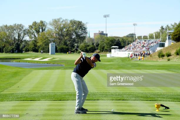 Matt Kuchar of the US Team plays a shot during Thursday foursome matches of the Presidents Cup at Liberty National Golf Club on September 28 2017 in...