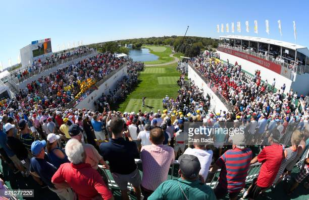 Matt Kuchar of the US Team plays a shot on the first tee during the first round of the Presidents Cup at Liberty National Golf Club on September 28...