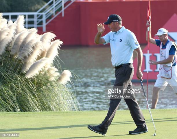 Matt Kuchar of the US waves to the crowd during the third round of the WGCHSBC Champions at the Sheshan International golf club in Shanghai on...