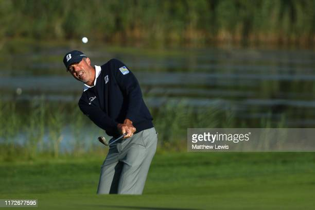 Matt Kuchar of the USA chips on to the green on the 12th hole during Day 2 of the Porsche European Open at Green Eagle Golf Course on September 06...
