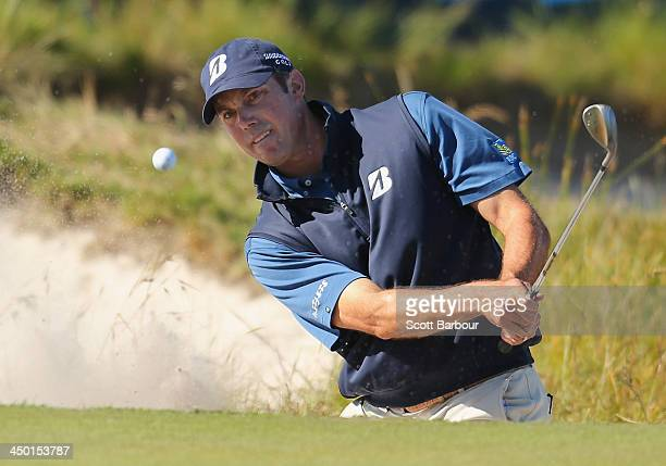 Matt Kuchar of the USA plays a shot out of a bunker on the 18th hole during round four of the 2013 Australian Masters at Royal Melbourne Golf Course...